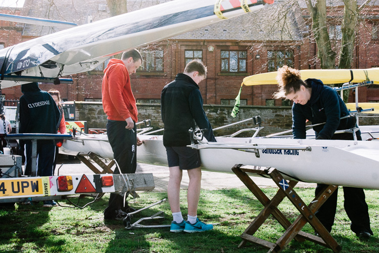 The crew preparing their boat for racing