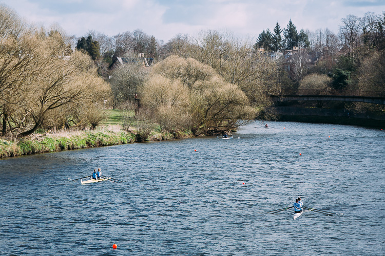 Boats apearing from the race start on the river Nith