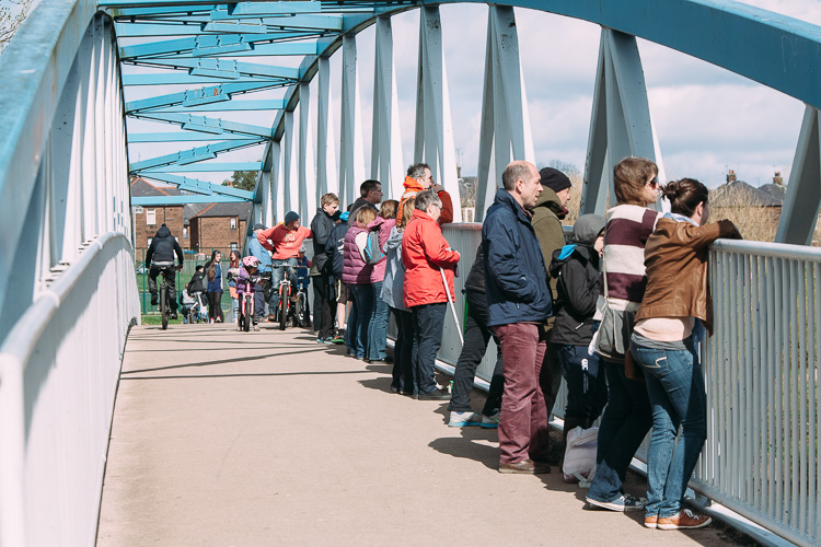 Crowds on the cycle bridge that served as the finishing line of Nithsdale regatta