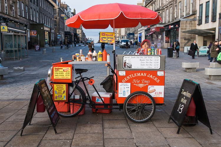 A hot dog stand and vendor on Princes Street, Edinburgh