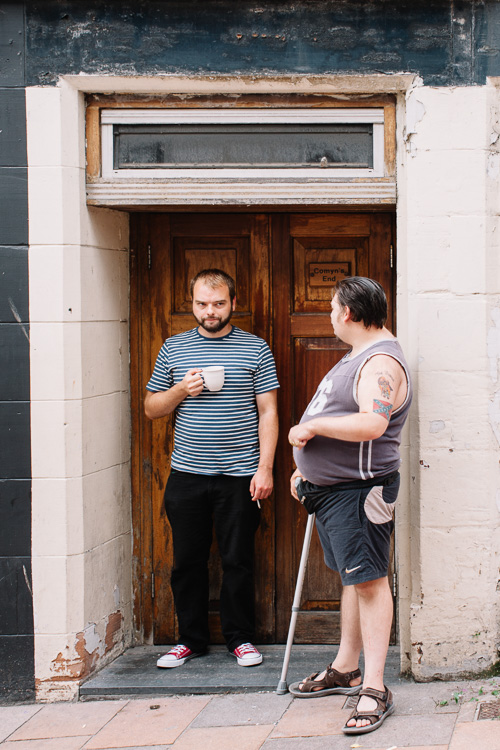 Two men in conversation outside Comyn's End building approximately where Comyn was actually slain