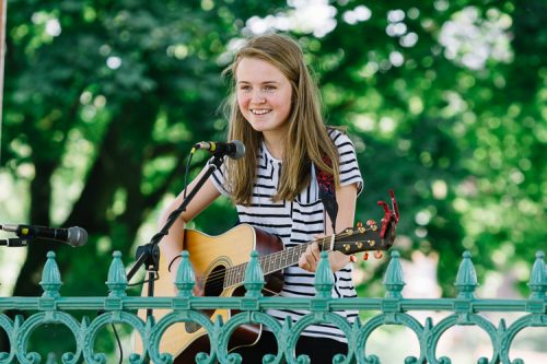 Kate Kyle, young songwriter and guitarist, performs at Dock park