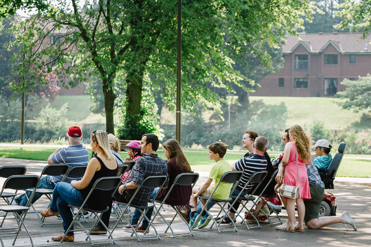 Family audience listening to the Dock Park bandstand concert