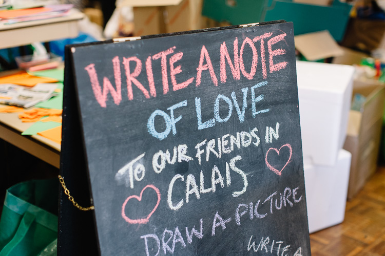 A table with art supplies where anyone could write a note of love and solidarity and draw pictures