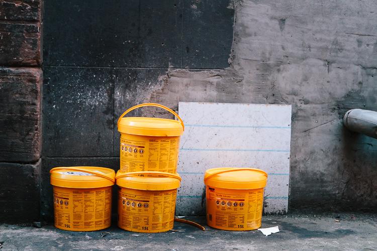 Minimal - orange tubs against concrete wall