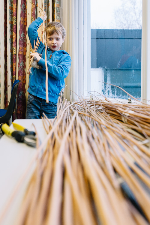 Boy picking materials for his lantern frame