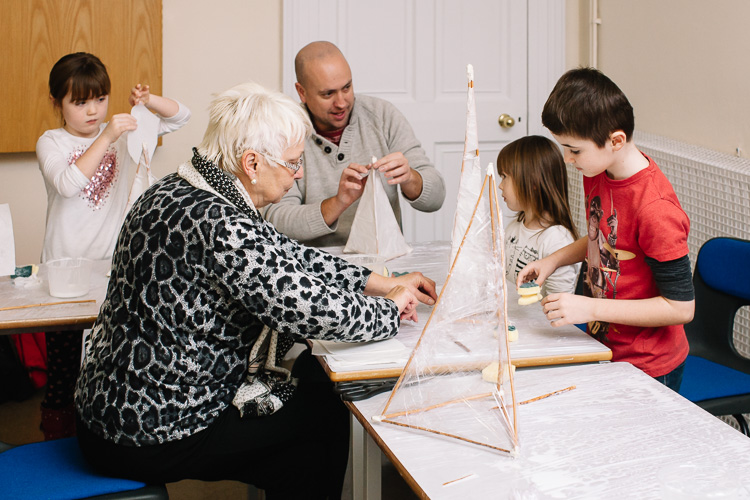 Tree generations of the family work together at lantern making workshop