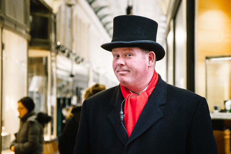 A red-scarved usher at the entrance of the Argyle Arcade