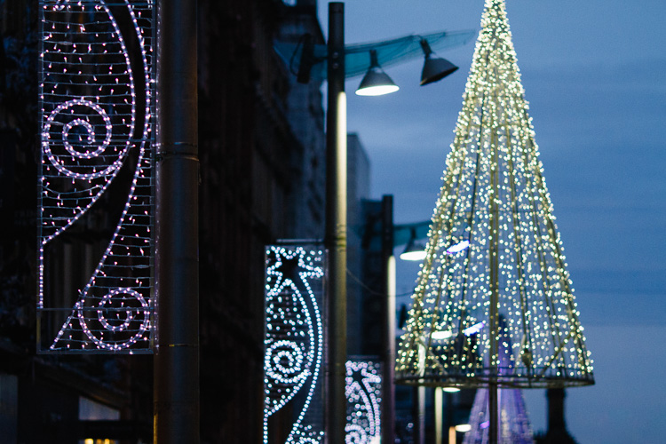 Festive lights switch on at dusk on the streets of Glasgow