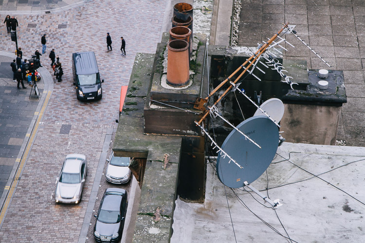 The scale contrast - satellite dishes and passers-by