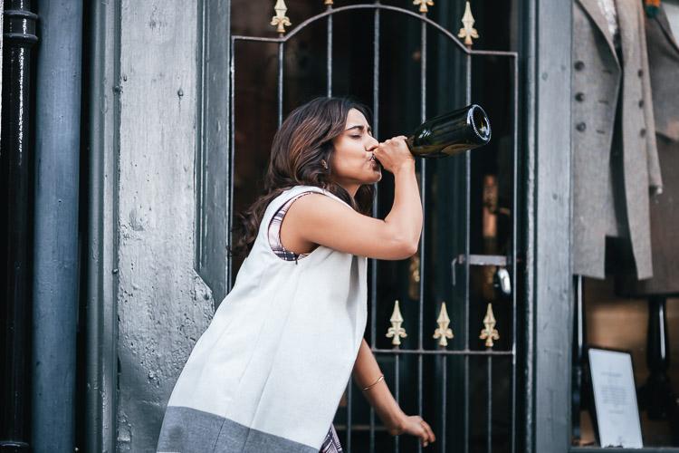 Tum Bin 2 female lead Neha Sharma in a scene with a champagne bottle