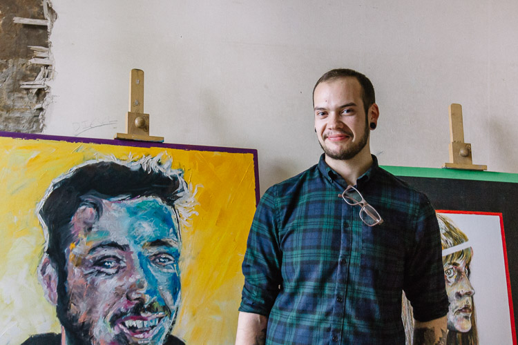 Alex Sharpe with his paintings