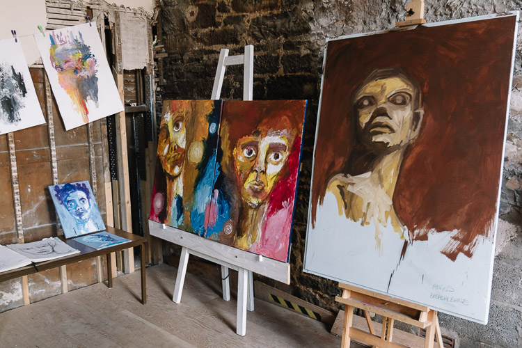 Large scale portraits by Angus Breadalbane at the  end of the year art exhibition in Moat Brae