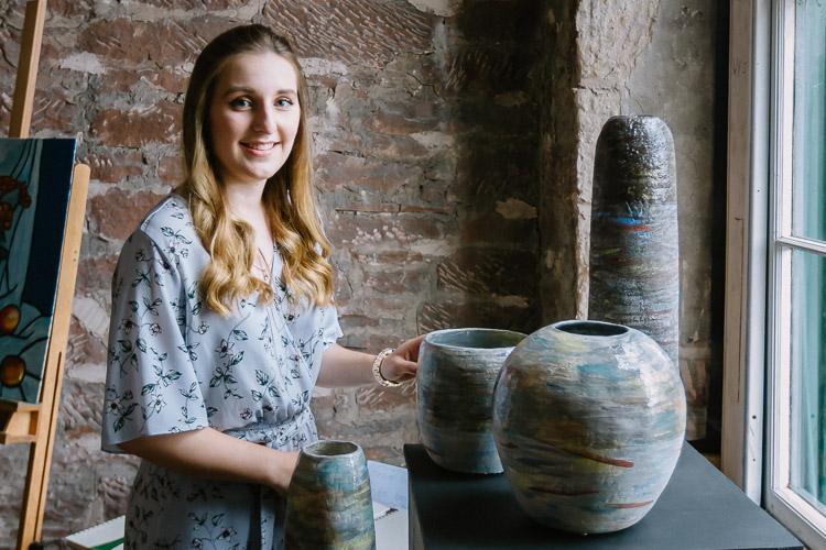 Sarah Robertson with her ceramics
