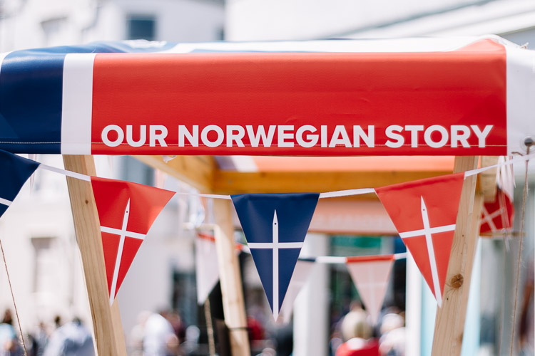 The stall decorated with Norwegian flags is not only used to sell Nordic delicacies but to tell the Norwegian cultural story of Dumfries