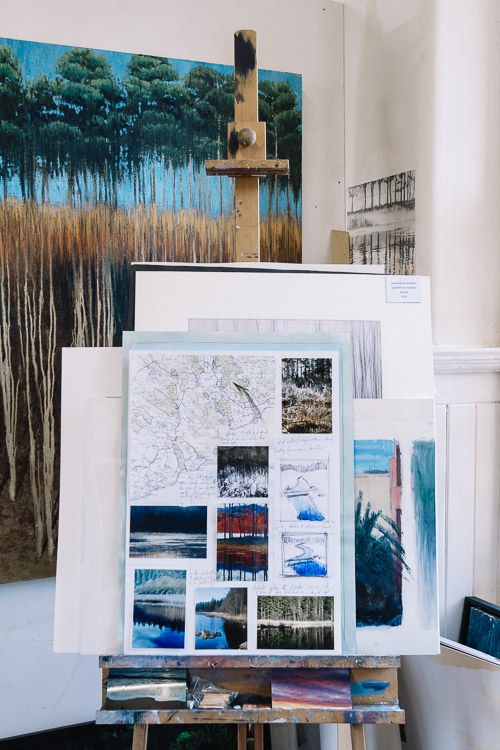 An easel with Willliam's research and sources of inspiration for Dumfries and Galloway landscapes