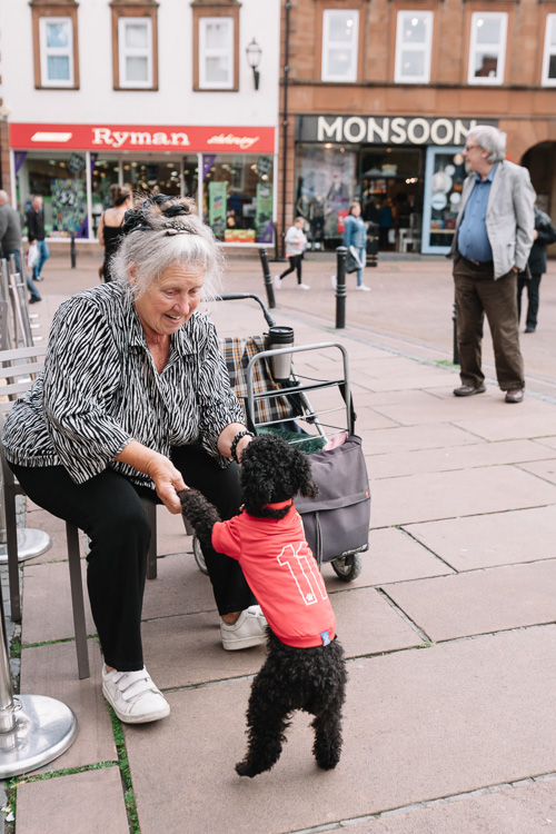 An old lady leads her poodle in a dance to some Carlisle Fringe 2016 performers' tunes