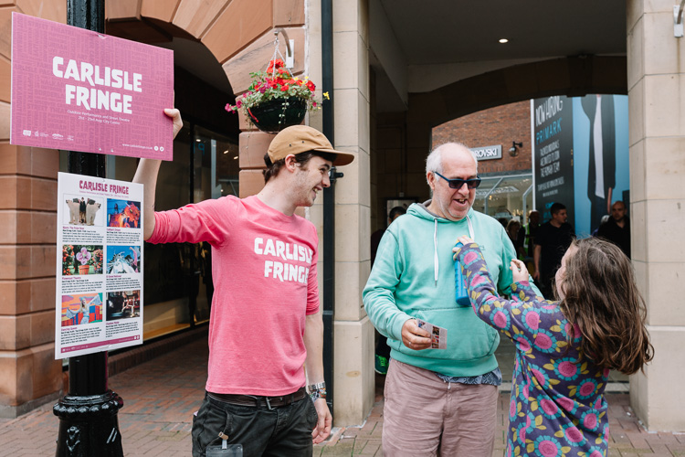 The locals having a chat with Jack Finlay about the Carlisle Fringe programme