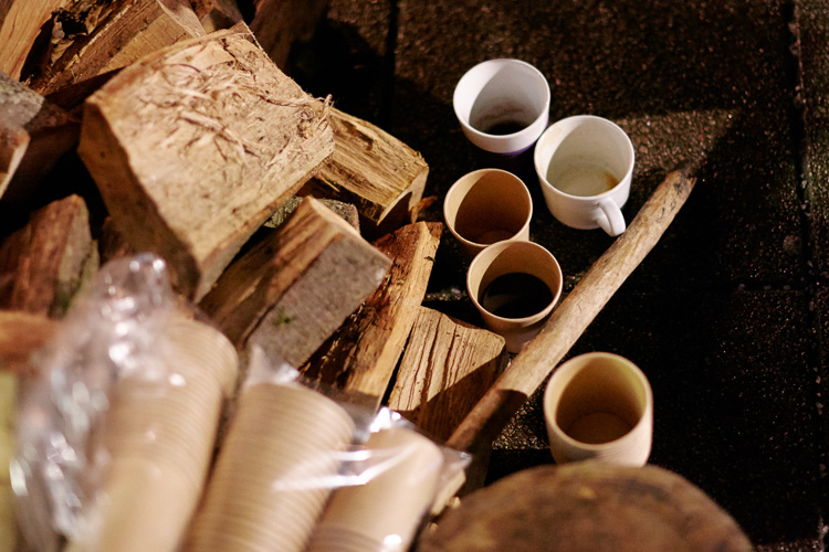 Cups for mulled wine and timber for the fire