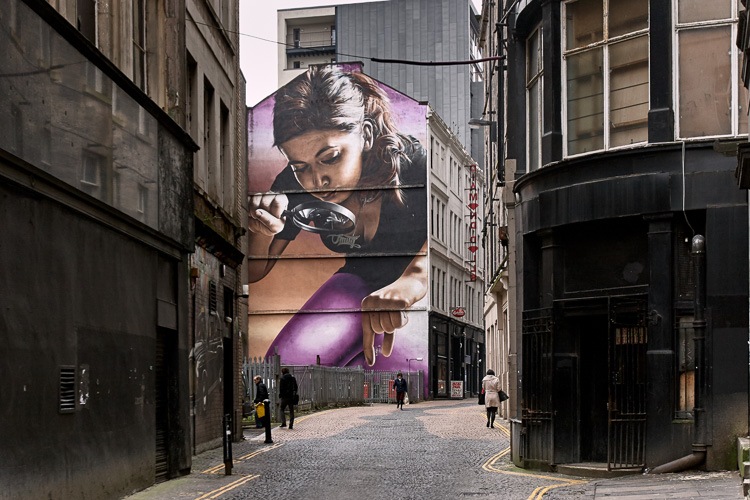 Glasgow street art by Smug - Girl Examining the Passersby