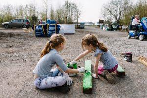 Little Sandside residents painting wood