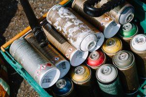 Spray painting cans stash for the workshop at Sandside community garden