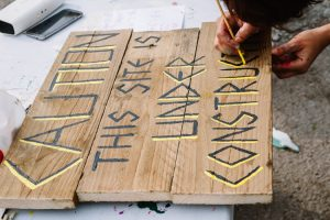 Apache Land style sign being created