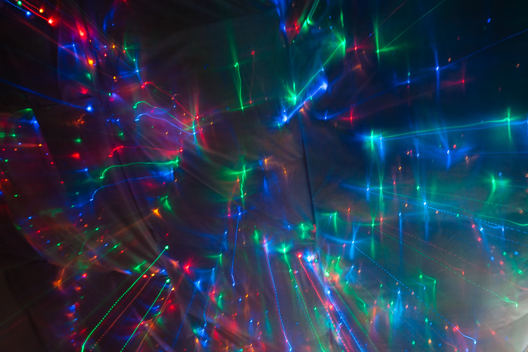 Multi-coloured fairy lights ceiling in Light Room installation and sharing space