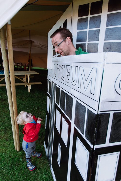 "Father and son playign with Hugh Bryden's model of the Lyceum, a preview of the upcoming ""Forgotten Doors"" exhibition"