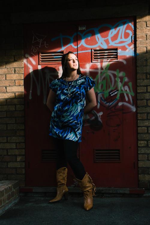 Charlotte against a graffiti door