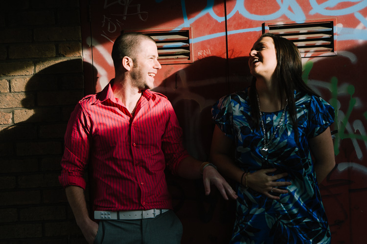 A couple in dramatic urban light