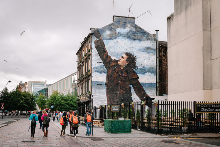 Glasgow Mural Trail visitors outside Hootenanny Bar at Dixon Street
