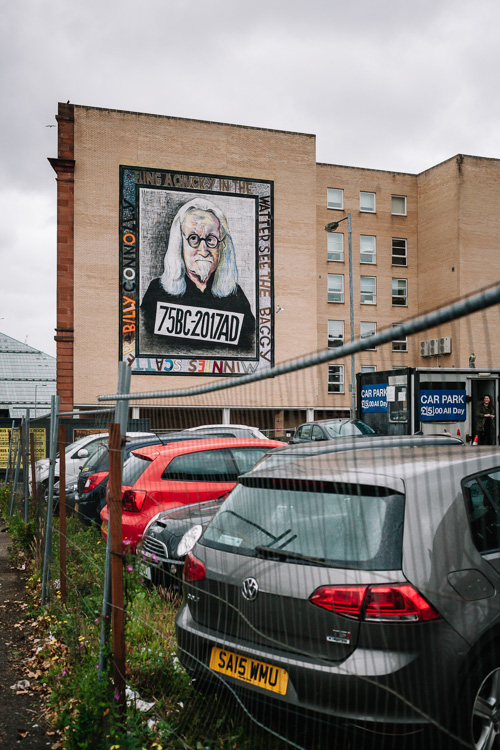 Osborne Street Billy Connolly mural with the local car park at the foreground