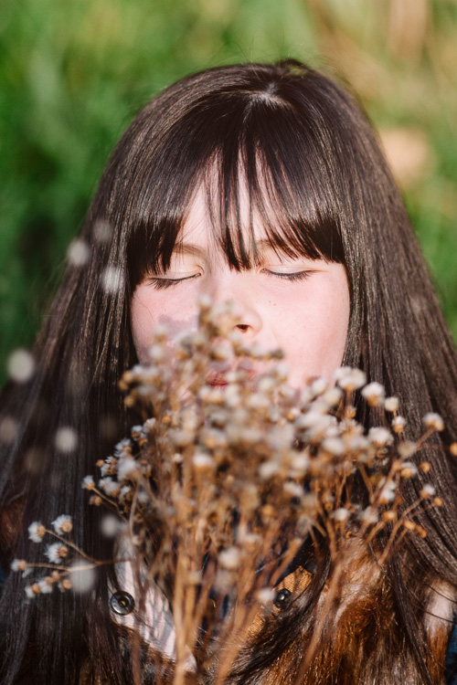 Girl blowing the dried seeds