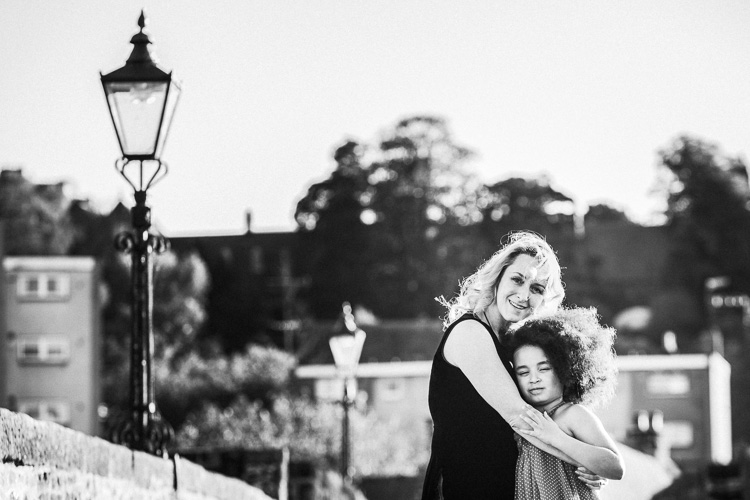 Mother hugging her daughter during Urban Portraits Dumfries project shoot