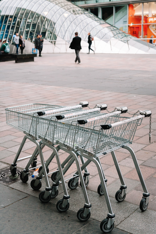 The set of shopping trolleys of with St Enoch subway station in the background