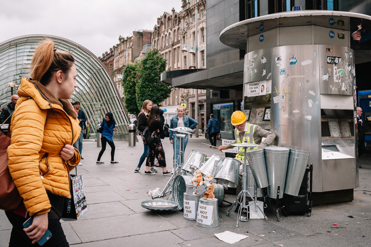 Techno Tin Bin Man steet performance outside St Enoch subway