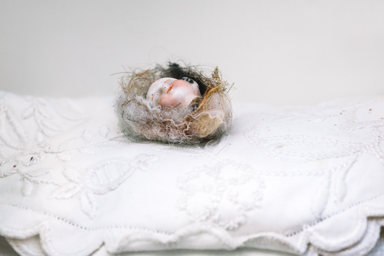 Close-up of the nested baby's face on the top of the pillow tower (kate Mink, A place to rest your weary head)