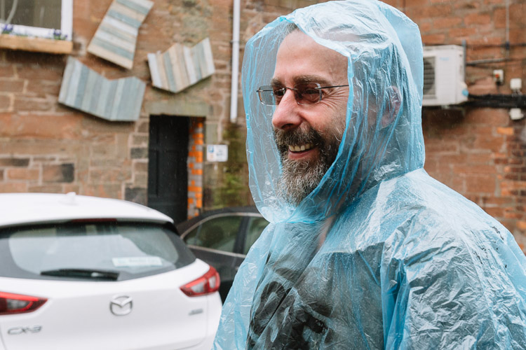 Sociologist Andy Zieleniec who guides Close Encounters walk is cheerful despite the rain