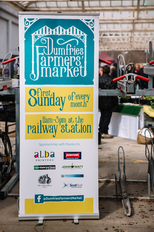 Dumfries farmers' Market sign with a new logo incorporating the railway station Victorian Pavilion