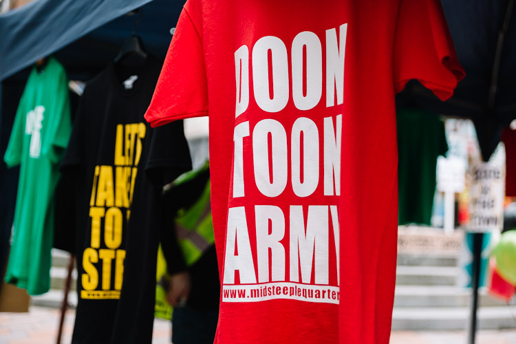 Doon Toon Army T-shirts on offer at the information desk