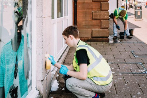A teen Doonhamer scrubbing the walls from the moss