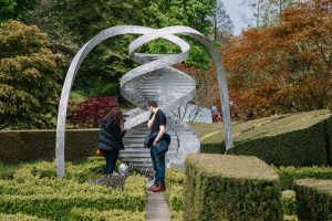 A couple examining the double helix sculpture