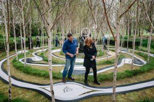 Visitors follow the labyrinth of Birchbone Garden