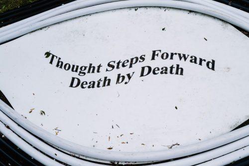 Memento mori inscription on the ground of Birchbone Garden