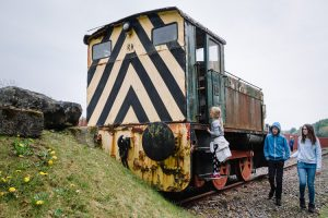 Girl climbing the disused locomotive