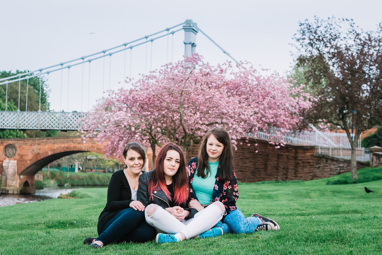 Group portrait in front of the suspension bridge and the tree in full bloom