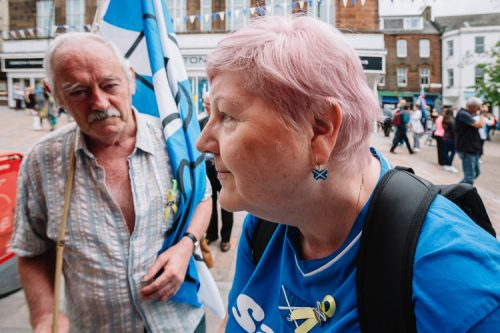 Pro-independence merchadise - a woman shows her patriotic earrings to me