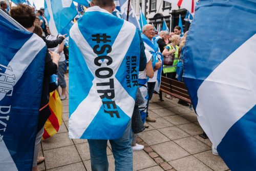 People wrapped in Scottish flags