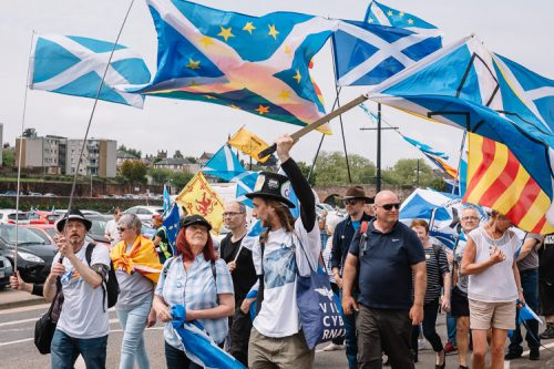 Scottish EU remainers stars, saltire and Catalan flags in All Under One Banner rally in Dumfries